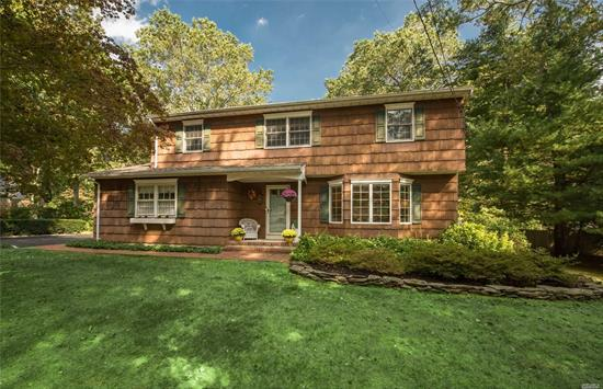 Located on a beautiful tree-lined street in the heart of St. James, this 4BR, 2.5BA colonial boasts HWF throughout, den w beautiful fireplace, CAC &large master en-suite w WIC and master BA. Loaded with sun-light, the principle rooms are spacious and perfect for entertaining. Full fin basement has a wet bar and OSE. 2 car garage, roof 6 yr old. Great opportunity in St. James!