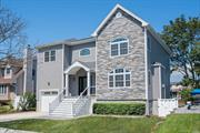 Waterfront new construction! No expense spared in this 2018 raised Colonial in Baldwin Harbor w/ direct water access, new bulkhead & sunrise/sunset views. Entertain effortlessly in this open floor plan featuring a chic eat in kitchen adjoining living rm w/ gas fpl & dining rm w/ french doors to Trex deck. Hardwood floors throughout, high ceilings & oversized windows bring in abundance of natural light. All bedrooms have waterviews & walk in closets w/ custom organizers. Garage w/ room for lift.