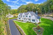Exquisite Laurel Hollow masterpiece by one of Long Island's premier builders. 5800 square foot 6 bed/6.5 baths, 3-car garage, 10' basement, CSH schools, custom mill work incl. two-story raised panel foyer, coffered ceilings, 2-story family room, 2 fireplaces, 2 laundry rooms, Huberwood ZIPsystem w/ spray foam insulation, Extensive masonry package including outdoor covered pavillion, professionally landscaped! Still time for you to choose paint colors and wood floor stain!! Home is 95% complete!