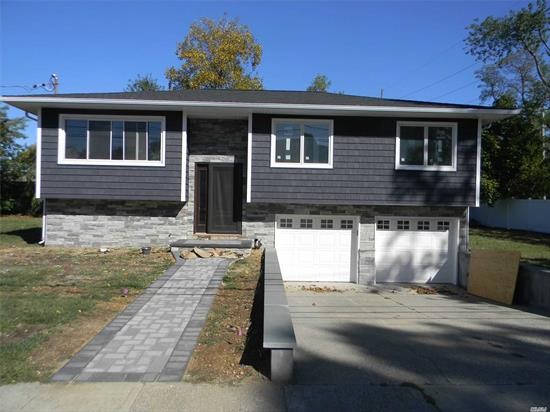 Spacious And All NEW (Kitchen & Baths etc ) Wide-Line High Ranch Including 4 Bedrooms, 2 Full Baths, Full Dining Room, Living Room, Hardwood Floors Throughout, Beautiful Yard. 2 Car Garage, Close To All. Available Nov 15th