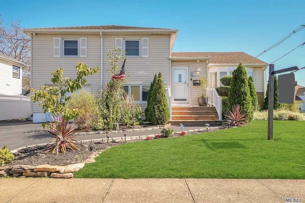 This Lovely Split Level Home sits on a Large Corner Lot close to Freeport's Nautical Mile. Light, Bright, and Spacious, this home boasts 3 Bedrooms, 2 Updated Baths, an Updated Kitchen w/Center Island, Granite Counters, SS Appliances, Dining Area with Sliders to a Multi-Level Deck Featuring an Old Train Car, Beautifully Landscaped yard Perfect for Entertaining. On the 2nd floor is the Master w/oversized WIC, 2nd bedroom, F/Bath, & Laundry rm, the Lower Level has 3rd bedroom, Den, F/bath, & OSE.