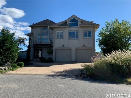 Fabulous Bay Front Property with 6000 Sq Ft Trex Deck, IGP, 200 ft. Bulkhead, Cut-In Boat Slip, Gourmet Kitchen and Unbelievable Water Views. This home has 5 bedrooms, and 3 1/2 baths plus 3rd level bonus room for home office or home theatre with gorgeous views.