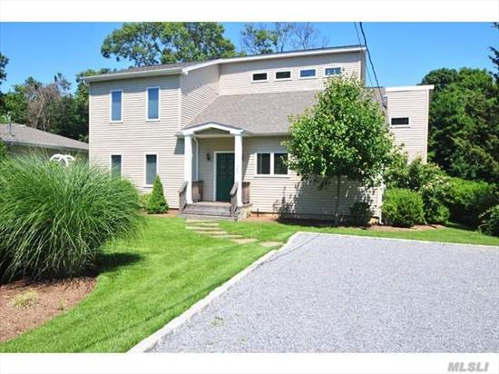 Founders Landing Southold Neighborhood Contemporary Home with vaulted livingroom ceiling. All new expansive rear deck. Designed for one level living with first floor bedroom suite, and laundry. Additional 2 bedrooms, and full bath upstairs. Sliders to rear deck and yard. Central air. Moments to Founders Landing Park/Beach and Southold Village.