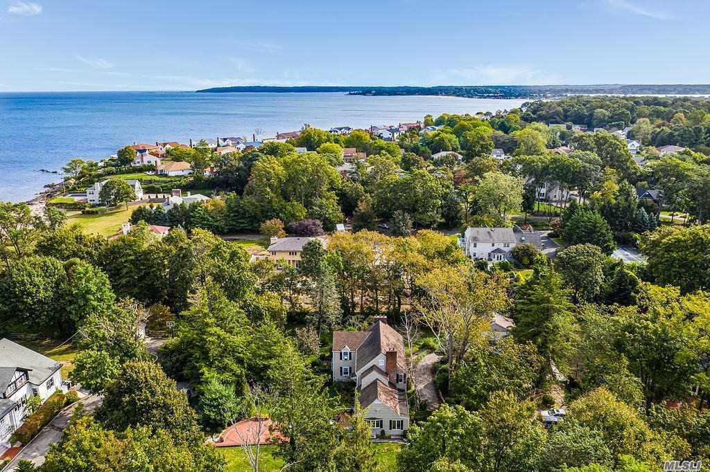 Steps from The Beach...Traditional 1930's Colonial 4 Beds, 4 1/2 Bath & over 3200 sqft of living space on 1.06 Acres of Private Tree Lined Property... Eat In Kitchen w/Lots of Cabinets & Thermador Appliances, Formal Living & Dining Rm w/Fireplace, Den, Office & Covered Porch, 2nd Fl Master w/Fireplace & Double Closets, Bath, 3 Beds & 2 Baths, Brick Patio & Garden for Entertaining, Private Beach & Mooring Rights, Hardwood & Hi Hats, 200 AMP Ele, IGS, Gas Heating & HW, Locust Valley SD, Tax Grieved