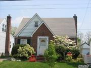 PRICED TO SELL... LOCATION....LOCATION....LOCATION....Must see this Brick 4 bedroom cape located in the heart of Franklin Square.. Park Like street. School District #17 Polk Street Elementary School and H. Frank Carey H.S.  Close to parks, stores, schools and transportation.  Needs TLC.. New Architectural Roof, New Boiler, Gas in house, New front door, vinyl windows.