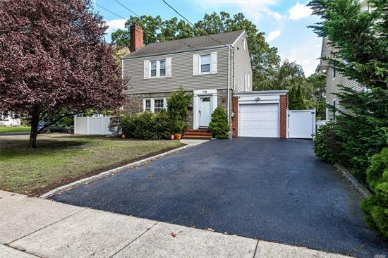 3 Bedroom Side Hall Colonial Set On Oversized Property (75 x 100). House Features Large Living Room With Wood burning Fireplace, Formal Dining Room, Eat-In Kitchen, 3 Large Bedrooms, New Bathrooms, New Roof, CAC, New Gas Burner, Gas HWH, And More.