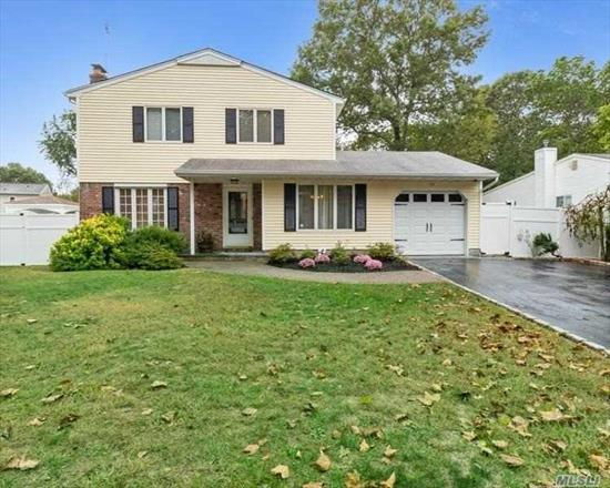 4 bedroom/1.5 bath colonial on a beautiful 1/2 acre fenced lot with built-in pool (loop-lock cover). This home offers central air (2016), 2 zone gas heat, all new stainless appliances, fireplace, garage, Andersen Windows, new hot-water heater (2017), new garage door, wood floors and hard wired for a security system. The location is perfect! Sidewalks/interior street/EZ access to parkway and LIRR. This home has beautiful views from the kitchen & eating area and is just filled with sunlight