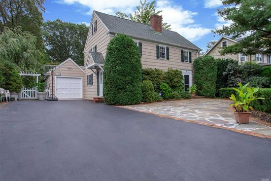 Charming 1939 New England Style Saltbox Colonial, Nestled on a picturesque .5 acre in the heart of Hunt Village. White picket fence, Enchanting Entry w/ Bluestone Courtyard. 3 Bedrm 2.5 ba home. Open floor plan Warm EF, Gourmet EIK w/Granite tops & SS app's, Den, DR, LR w/ FPL , built in book shelves, Wood floors thru out, Custom floor & Ceiling moldings. French doors to Huge Adirondack style Fam/Sun Rm/ Yr Rd w/ Lg Windows, Wd Burning Stove, Beautiful Lndscape, New CAC, Pella Wds, Close to all!