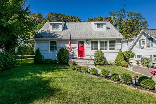 Charming, move-in ready home minutes to Huntington Village. Sun-filled rooms, updated kitchen and bath, newly redone basement, 200 amp elec 2014, hot water heater 2016. Option for first floor master. Fully fenced rear yard with new plantings and paver patio.