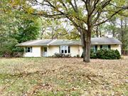 Excellent location on 1/2 acre flat property in Miller Place schools. Loads of potential! Updated windows and vinyl siding.