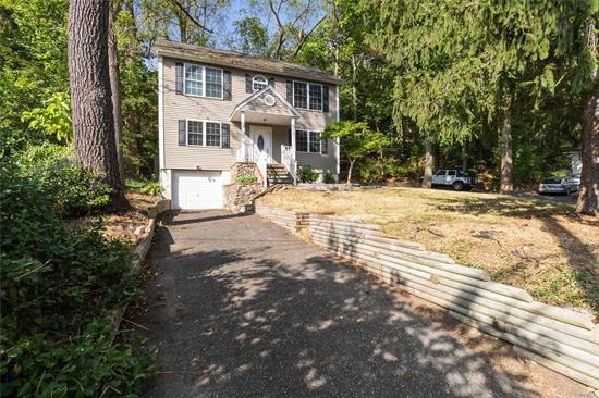 Unique Older Colonial renovated and ready for your finishing touches! Open floor plan on first floor with traditional second floor bedroom layout. Easy maintenance with natural landscape. Home features new heating system, hardwood floors, sheet rock walls and baths. Harborfields # 6 School District