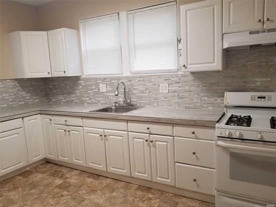 New Kitchen, clean, freshly painted 2 BR apartment, new floors. 1st floor only. Water included. Driveway parking.Close to stores and train station. 1 Month security, 1 months rent, 1 months broker fee.Application required through- National Tenant Network(NTN)
