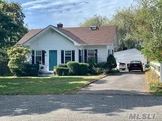 Perfect opportunity to live in one of East Moriches most desirable locations. Nestled perfectly on a quiet, dead end street this 2 Bedroom boasts a gorgeous pond in the backyard large enough for kayaking, large eat in kitchen, generous living room & is steps to an idilic & protected cove on Moriches Bay. Detached garage is framed & ready for a pond view artists studio. Your choice of 3 High Schools: WHB, ESM or CM. Great opportunity for the right buyer and priced to sell. Wont Last!