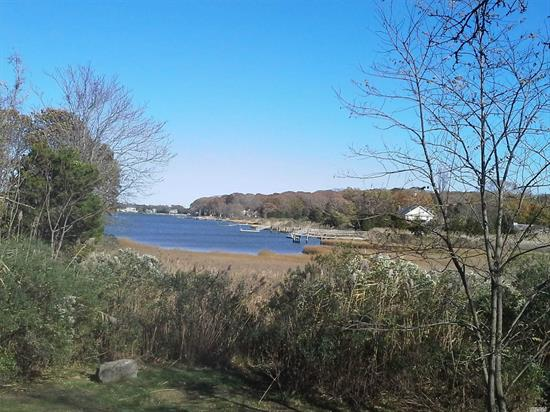 Charming 2, 500+ Sq. Ft. Home with Creek Views on .75 Ac. 3/4 Bedrooms, 2 Baths, Large Living Room  Kitchen, Dining Area. family rm large closets Bay Beach Nearby.