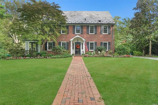 Traditional Stately Colonial Set On Just Shy Of Half An Acre On The Prestigious Colonial Pkwy. Gracious Entry Foyer Opens To The FDR, Oversized LR w/ WBF and Fr Doors To Covered Porch, Huge Chef's EIK w/ High End SS Appliances And Massive Island. Grand Staircase Leads To The Master Suite And 3 Additional Large Family Bedrooms As Well As An Updated Bath And Walk-Up Third Floor Bonus Room W/ Ample Storage.
