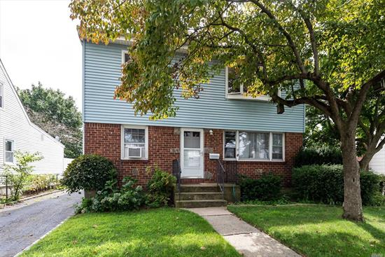 a large 2 bedroom, with a large living room , huge kitchen with possible dining room, 2 bedrooms, full bath, hardwood floors, finished basement with laundry, private backyard with use of garage- a must see-!!!