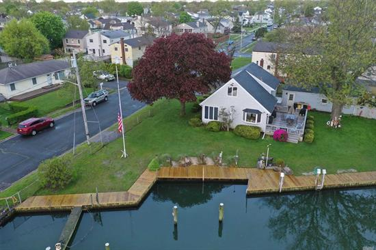 Beautiful Waterfront Home with 120' of Bulkheading, 6 Dock Slips, Large Detached 2-Car Garage W/Workshop, 3 Bedrooms, 2 Full Baths, Lovely Kitchen, LR, Den...All on Private, Quiet Dead-End Location, $700 Fema Flood. Spacious Living.