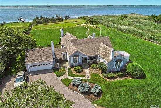 Charming 3BR, 3BA shingled bayside cottage. Formal dining, living room with vaulted ceilings, den, 3 fireplaces, cook's kitchen, mudroom, laundry room & 2-car garage w/workshop. On 1.64 acres with a large deck with views of Moriches Bay, lush lawn, inground pool surrounded by an English garden. Enjoy you own private bay beach & an extended dock for watercraft. This meticulously cultivated estate is truly heaven. Make it your waterfront dream home.