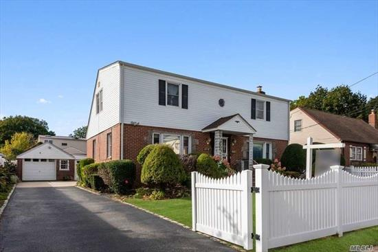 Lg colonial w/ M/D potential, new roof, solar panels, CAC, HW flrs, Gas ht, updated kit w/ granite & stainless appl, newer doors (front & rear), mostly all replaced wdws, updated bath, ring system, vivent alarm, 2 sec. cameras , new washer/dryer, new hot water htr & boiler& chimney, french drain, PVC fence, Seller makes no representation for 1/2 bath. Taxes do not reflect STAR