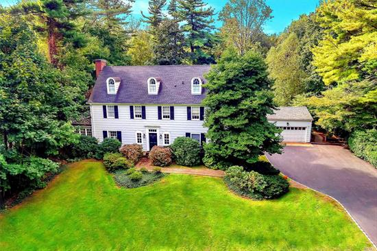 Stately Williamsburg Colonial. Perfectly situated on one of the three best properties in Roslyn Estates. Flat Shy Acre 145x252 lot. Nestled in a country setting. Only 17 mi to NYC Convienient to luxury shopping, dining, train to Manhattan and the picturesque Village of Roslyn Perfect for year round entertaining Approx. 3300 square ft of charm and privacy.