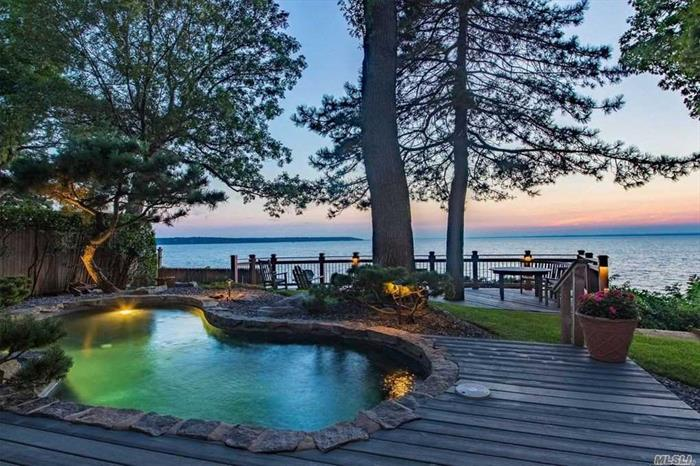 Fabulous waterfront home with panoramic views to CT. Inviting floor plan.. Spectacular sunsets, heated in ground pool. Perfect floor plan for entertaining year round. Walls of glass surround this unique and very special waterfront home.