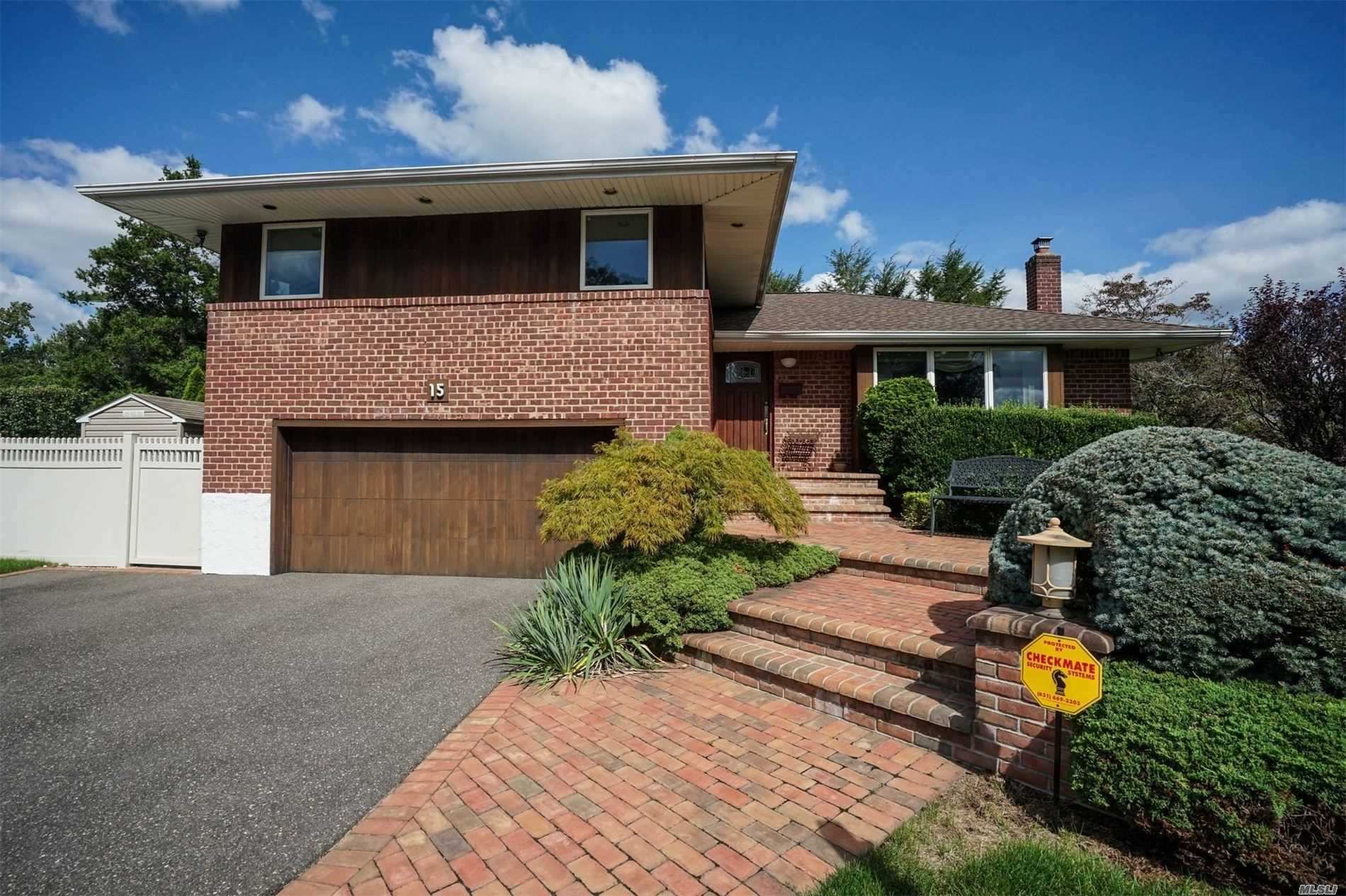 Perfection in Woodbury Hills! This Spacious light & bright Split is fully bricked and set on a prime 73x116 Property with an in- ground heated vinyl pool! Large Kitchen with Stainless Appliances, large entertaining rooms, master with bath, in ground sprinklers, 2 car garage, & CAC! privacy Galore ...all in Plainview School District! Will not last!