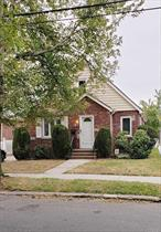 Well maintained Cape home on a beautiful quiet street in Fresh Meadows, new Pavered Driveway, Large rooms throughout, Front entrance and side entrance, Beautiful large finished basement, School District 25, Near transportation and shopping. Move in Ready