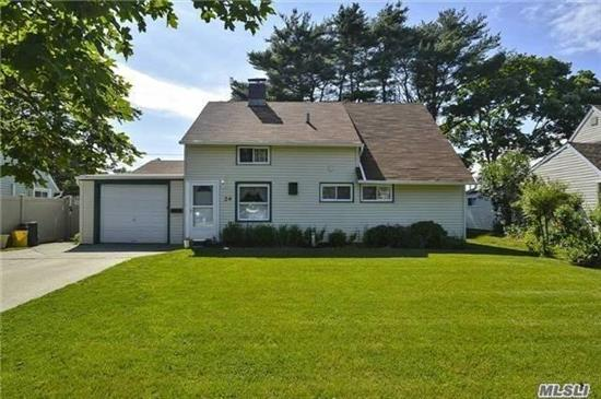 Move right into this expanded Levitt Ranch on a 60 x 100 lot in Hicksville! Updated eat in kitchen, living room, dining room with fireplace, 4 bedrooms and 2 full baths.  Master bedroom on first floor, over head lighting, attached garage, above ground oil tank, private fenced in backyard with a cement patio and awning.  Move in ready! Low taxes!  Hicksville School District #17 / Taxes W/STAR: $6,885 / Fuel: Oil / Heat: Hot Water.
