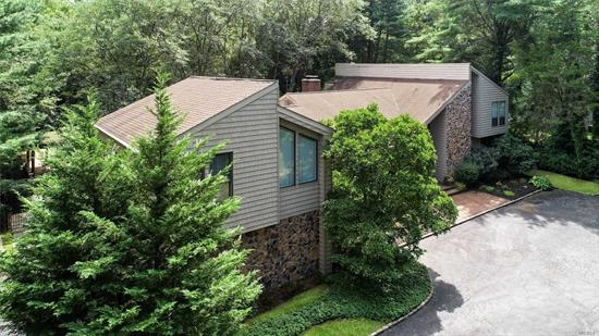 Custom Built By Joseph Omland, Renowned Builder On LI. Superior Location In North Syosset W/ Total Privacy. Very Low Taxes. Oversized Deck Overlooking Gunite Inground Pool And Lush Landscaping. Master Suite On Main With New Master Bath. Additional 4 BRs And An Additional Master Suite In Its Own Level Above Garage. Gourmet Chef Center Isle Eat-In-Kitchen Detailed To The 9s. Custom Medieval Entrance Doors W/New Stone And Siding. Over 2500sf Basement, 2.5-Car Garage. Syosset SD (BH Elem/SW Middle).