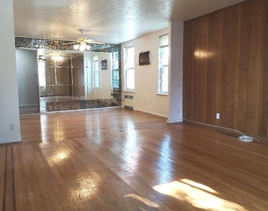 Large 2 Bedroom Apartment for Rent in Rego Park. Features a Living Room, Dining Room, Kitchen and 1 Full Bath. Parking Available for Additional Fee. Conveniently Located Near Shopping & Transportation.