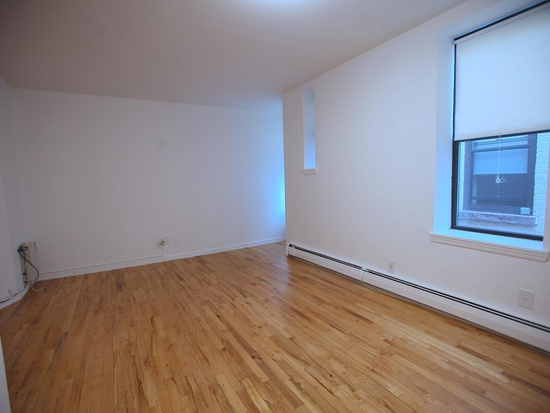 Must See! 2BR/1BATH in elevator bldg. Hardwood floors throughout. Renovated kitchen and bath. Close to NYC transportation. Laundry in the building. Heat and hot water included in the rent. Do not miss out!