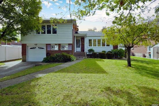 Lovely Expanded Brick Split Level Home Set On A Quiet Tree Lined Street In Massapequa Park. This Home Features Newly Refinished Gleaming Hardwood Floors, Andersen Windows, Updated Kitchen w/Custom Cabinets, Stainless Steel Appliances, Gas Cooking & Heat, Living Room, Dining Room W/One Of A Kind Hans Gabali Mural, Family Room W/Wood Burning Fireplace, Den With Outside Entrance To Private Back Yard, 1 Car Garage. Close To Schools , Shopping & Transportation . A Must See !