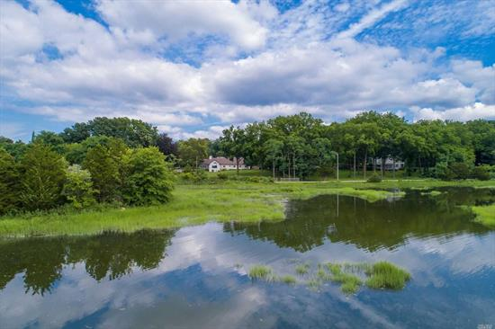 Commanding views over Oyster Bay Harbor in the beautiful European farm ranch in the prestigious village of Cove Neck. Comfortable floor plan delivers new master suite, 3 large bedrooms, full bath, new gourmet kitchen, sun room and spacious living room with fireplace. Ideally set on over 3 acres.
