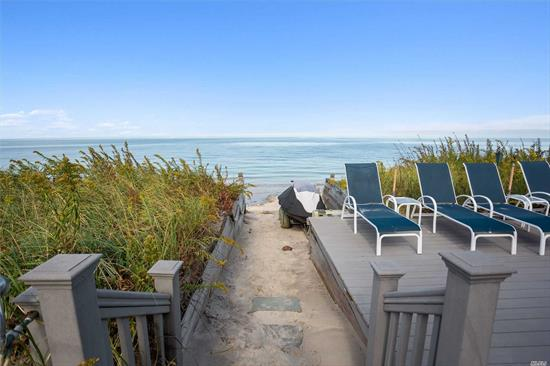 Beautiful, Direct Waterfront Beach House with Long Island Sound and the Beach as your Backyard! Designer Decorated and Completely Updated, Room for Guests and Spectacular Water Views. Large Deck w/Retractable Awning, Summer Kitchen, Outdoor Shower, Indoor/Outdoor Sound System, Hot Tub, Launch for Jet Ski and All Just a Few Steps From Your Backyard Beach. Nearby is Top Rated Dining and North Fork Wineries & Vineyards. The Perfect Beach Home!