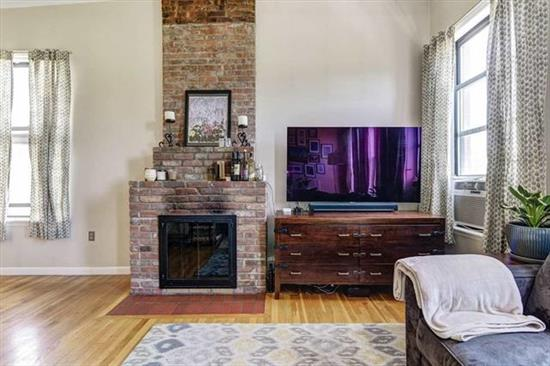 Walk home into this bright and beautiful 2bed condo in Historic Van Vorst Park neighborhood. This top floor corner Unit has it all: NYC views, wood burning fireplace with exposed brick, washer/dryer in unit, custom closets, ample closet space, and additional storage in basement. Shared roof deck with panoramic views, 14' ceilings, and beautiful hardwood floor complete the picture. Just steps to path, light rail, shops, restaurants and nightlife. Two flights up only.Low maintenance and taxes!Don't miss this one!