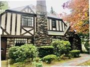 Charming Stone and Stucco English Tudor with loads of potential on oversized lot (60 x 140) in N. Strathmore. New CAC compressor (2 years old)