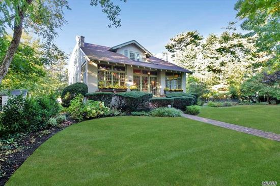 Truly extraordinary & spacious home situated in the heart of Brightwaters Vlg. At over 3000 sq. ft. this unique architectural gem is reminiscent of a historical era. Enter thru a unique patio w/stained glass windows & you will quickly find the generous sized LR w/fireplace & an elegant formal DR w/wide plank floors & high ceilings. A sun drenched den w/French doors leads to an impressively designed patio & yard.Perfect for entertaining both inside & out. Vlg amenities include dock, beach, & tennis