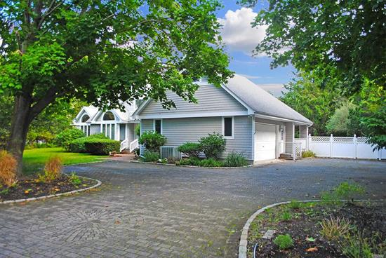 This lovely home is sited on about half an acre on a quiet cul-de-sac lane in coveted Quogue Village. The 2, 200? sf home features three bedrooms and three full baths. Master and junior master suites are offered on the first floor for easy living. The living room, with a wood burning fireplace, opens to the dining area, eat-in kitchen, and an office/sitting room. Relax in the library and the cozy loft area or enjoy the generous sunroom that looks out to the freeform gunite swimming pool. Outside,