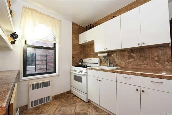 Updated 2 bedroom jr 4 apartment on the top floor with hardwood floors. Doorman building, laundry and bicycle room at premises.Facing Queens Boulevard.Just a few blocks away from E and F Van Wyck- Briarwood station. Close to supermarkets, stores and much more.