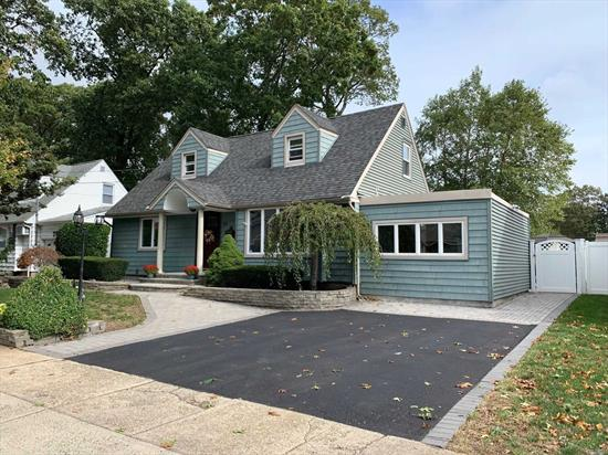 Beautiful Expanded Cape, Featuring: New Kitchen, Baths, Radiant Heat(2Bths), Skylite Living room, Large Full dining room, New Electric, Large Mastr Bedroom W/ Full bath & Walk-In-Closet, Full Finished Basement, New Siding, Pavers, Roof, Private Landscaped Yard W/ pond, Near To Vllage And Train, Sd#23, Taxes Do Not Include Star Exemption