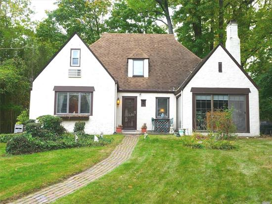 Heart of GN Village Charming Stucco Tudor; Best School District in NY and #3 in US: Elegant Cathedral Ceiling Lr w/Fireplace; Formal DR wi/ Original Built-ins; Eat-in Kitchen; Relax in the Solarium/Sunroom; 1st Floor Mstr w/ Ensuite Bathroom & Walk-in Closet; Additional Br & 1/2 Bath on Main; Hardwood Floors Throughout; Large Basement Playroom with Egress to Outside; Set Back on Park-like Grounds on Quiet Residential Block; Enjoy Parkwood Pool, Ice Skating Rink & Steppingstone Park.Low Taxes.