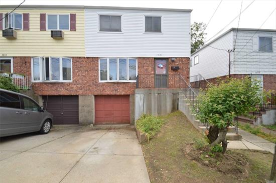 Semi Attached Brick/Aluminum 3 Bedroom Colonial Located On Quiet Street In The Heart Of Little Neck. Good Size Rooms, Lots Of Windows. Hardwood Floors (Under Carpet). Private Driveway, New Gas Heat (6yr Old) With Gas Hot Water Heater. District #26 Schools. Near Shopping, & Transportation. Lots of Potential.