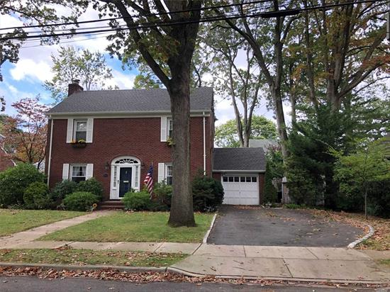 This House Is Awesome! Stately Brick Colonial Features FLR w/Fpl and Dutch Door Leading To Large Family Roomw/Slate Floor Overlooking Beautifully Manicured Grounds, FDR w/Chair Rail, Updated Kitchen w/Quartz C/T, Tiled Backsplash, & S.S. Appliances. Crown Molding & Nice Size Rooms Throughout. Great Additional Space In The Partially Finished Basement w/O.S.E. There's Also A Walk Up Attic, Attached Garage & Driveway Parking For 4 Cars. A Must See Beauty!