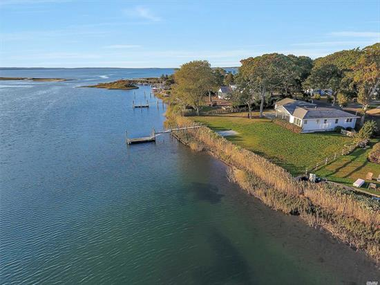 Enjoy the picturesque setting from this meticulously updated 3 bedroom, 3.5 bath home on half acre with 165 ft of expansive waterfront property w/ views over Corey Creek to the Peconic Bay. One level living w/ open floor plan features great room w/ fireplace, gourmet kitchen and an easy flow of indoor/outdoor space; perfect for entertaining. Covered bluestone waterside patio & dock with direct bay access plus deeded rights to Laughing Waters Association sandy beach.