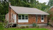 Tucked away on a quiet lane affording privacy, this affordable year round cottage has lots of potential if you're looking for a DIY project. Approx 1/3 mile to a gorgeous beach. Room for a pool. Low taxes.