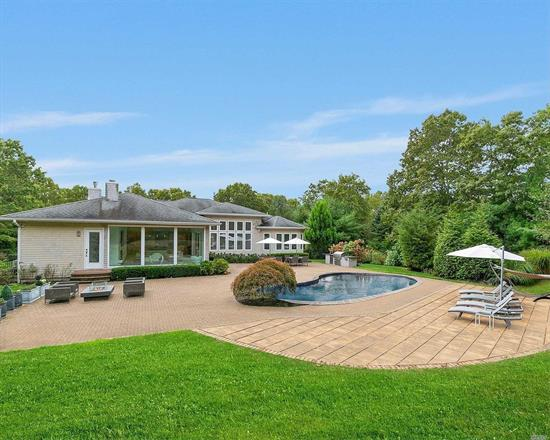 Totally Modern - Like Nothing Else in Southampton Pines. Pristine, turnkey home inside and out. Ideal for entertaining. Gourmet kitchen opens into a great room surrounded by walls of glass with views of a backyard oasis including meticulous gardens, heated pool, fire pit, and outdoor kitchen. Open concept living room and dining room, huge master suite, three guest bedrooms, large laundry room, and custom finishes throughout.