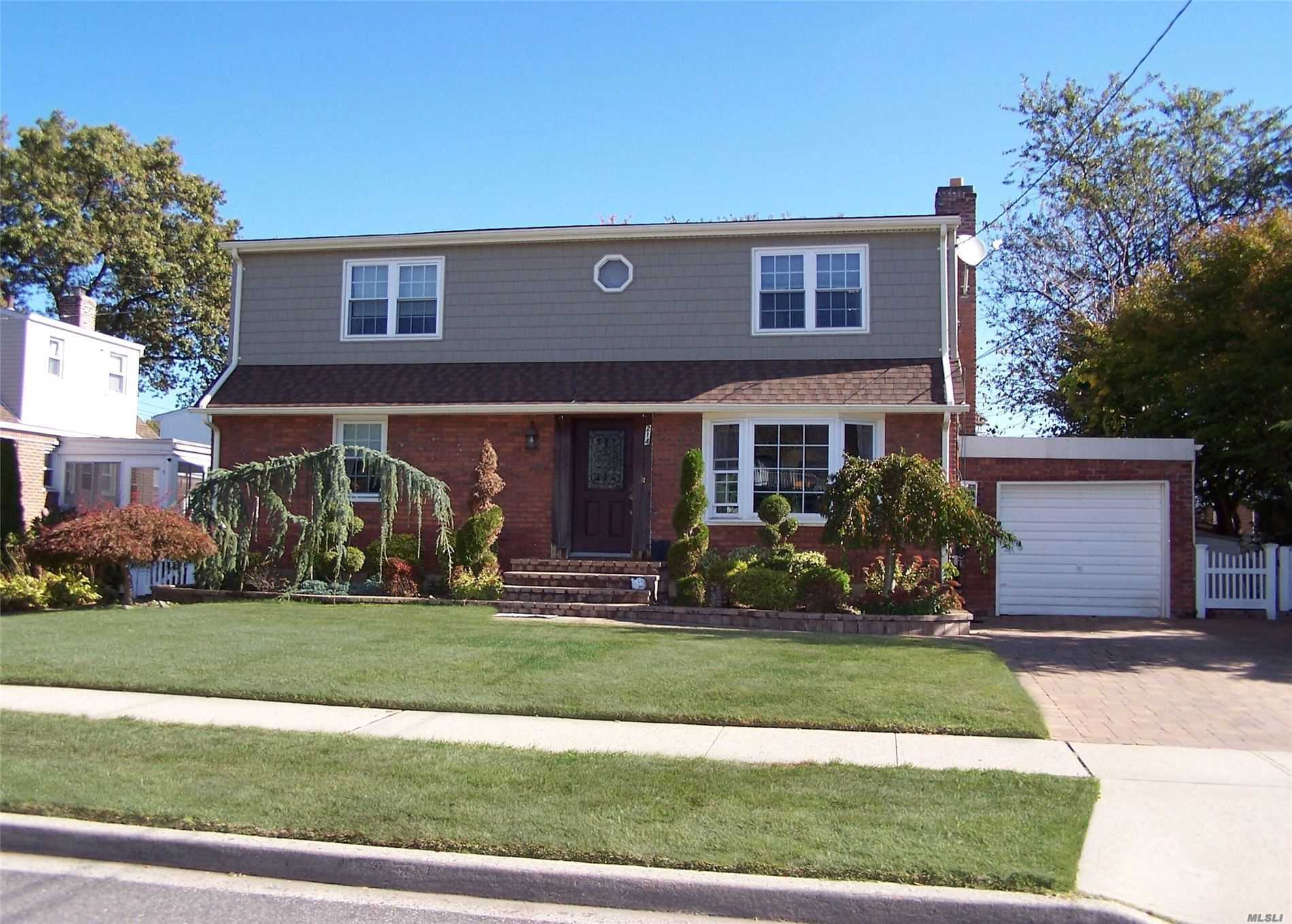 one of a kind! colonial In mint condition can be perfect for M/D . this cozy home feature:living-room, den, 2 kitchens, formal dining room, 6 bed, 3 full bath, , 1 car garage, this great home was updated 3 years ago.. new roof, new hot water heater, new siding, doors, windows, patio, paved driveway , professional landscaping ... and much more this home is calling you ! come and see!
