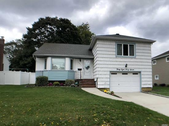 Great Split Level in Move In Condition. Clean and Bright with gleaming hardwood floors, large kitchen with stainless appliances, crown molding as a beautiful finishing touch. Manicured property with a large backyard for entertaining. A must see.REDUCED AND OWNER WANTS OFFER