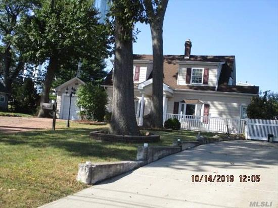 cozy 2 br colonial, conveniently located close to public transportation. clean with hardwood floor, garage and large yard