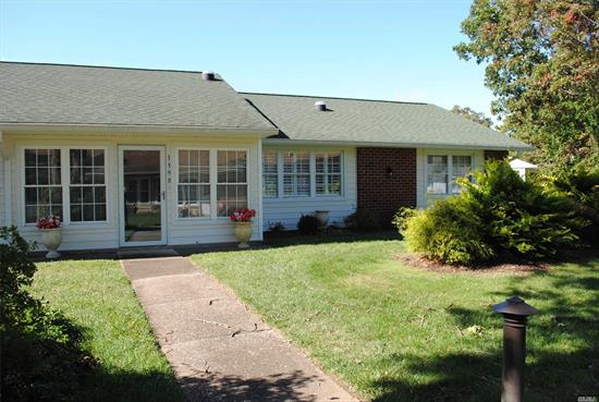 Absolutely stunning Baronet! Totally renovated - new kitchen with breakfast bar and extra cabinets, new bathroom with beautiful walk-in shower, laminate floors throughout, solar tubes, crown molding, custom shaker blinds, windows, all new interior and exterior doors, porch converted to sunroom with year-round use, and beautifully landscaped 3-foot area. Buy now, and you won't have to shovel snow this winter! Subject to terms and conditions of offering plan. Leisure Village has a one-pet policy.